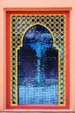 Rocznika nadokienny szkło na pomarańcze cementu ścianie Obraz Stock