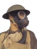 Rocznika żołnierz jest ubranym gasmask odizolowywającego Fotografia Stock