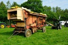 Rocznika rolny młócenie - maszyna Obrazy Royalty Free