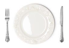 Rocznika talerz, nóż i rozwidlenie na białym tle, Fotografia Stock