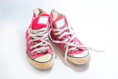 Roczniki będący ubranym sneakers na białym tle fotografia royalty free