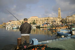 Rod fisherman in akko Stock Photo