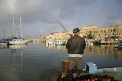 Rod fisherman in akko harbour Royalty Free Stock Photos