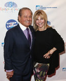 Rod Gilbert, Judy Christy. NEW YORK-MAR 28: Former NHL hockey player Rod Gilbert (L) and wife Judy Christy attend the 2015 Garden Of Laughs Comedy Benefit at the Royalty Free Stock Photos