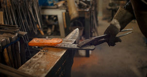 Rod hot iron on the anvil. Royalty Free Stock Image