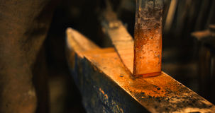 Rod Hot Iron On The Anvil. Stock Photography