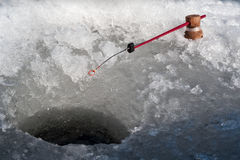 Fishing rod  at an ice hole . Royalty Free Stock Images