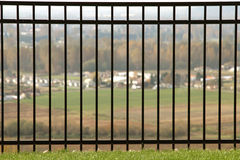 Rod Iron Fence With View Stock Foto