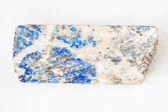 rod from Lazurite stone on white Royalty Free Stock Images