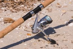 Rod and reel on a beach in Sardegna stock photo