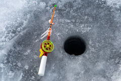 The rod for winter fishing. Lies near a hole Royalty Free Stock Images