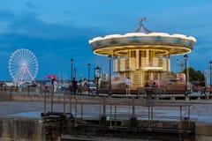 Roda de Caroussel e de ferris no porto de Honfleur Fotos de Stock