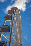 Roda de Ferris na água no por do sol Imagem de Stock Royalty Free