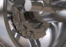 A roda de prata e o disco do freio em um cinza imagens de stock
