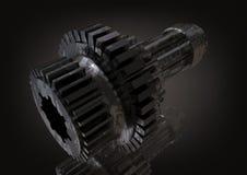 Roda denteada de prata e preta em um preto imagens de stock