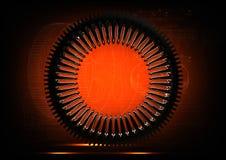 Roda denteada de prata em uma laranja imagens de stock