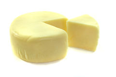 Roda do queijo com uma parte de queijo Foto de Stock
