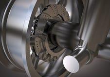 Roda e amortecedor de prata em um cinza imagem de stock royalty free