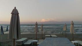 Roda plaża Corfu przy zmierzchem Obrazy Stock