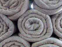 Rodado encima de Gray Spa Towel Imagen de archivo