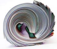 Rodado encima de la revista aislada en la macro blanca i Fotos de archivo libres de regalías