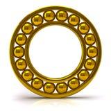 Rodamiento de bolitas de oro Foto de archivo