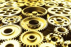 Rodas da roda denteada do metal do ouro Fotos de Stock