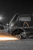 Rodas de carro com faíscas Fotos de Stock Royalty Free