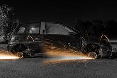 Rodas de carro com faíscas Fotografia de Stock