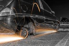 Rodas de carro com faíscas Imagem de Stock