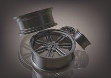 Rodas de carro prateadas em um cinza foto de stock royalty free