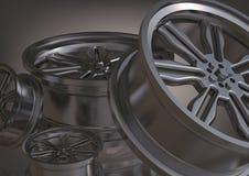 Rodas de carro prateadas em um cinza foto de stock