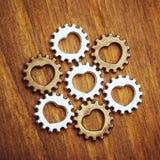 Rodas de engrenagem com símbolo do coração Imagem de Stock Royalty Free