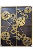 Rodas de engrenagem do ouro com correntes Imagem de Stock