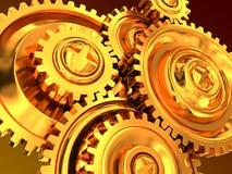 Rodas de engrenagem douradas Fotos de Stock