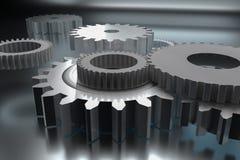 Rodas de engrenagem no fundo de brilho Fotografia de Stock Royalty Free