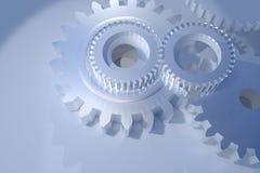 Rodas de engrenagem no fundo de brilho Imagens de Stock