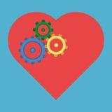 Rodas denteadas coloridas no coração Fotografia de Stock Royalty Free