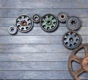 Rodas denteadas da madeira do fundo imagem de stock