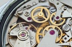 Rodas denteadas do metal no maquinismo de relojoaria, trabalhos de equipa do conceito Fotos de Stock Royalty Free