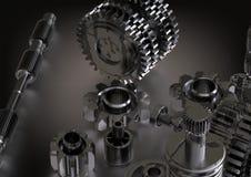 Rodas denteadas pretas e de prata em um branco imagem de stock