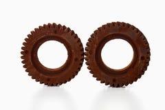 Rodas oxidadas da roda denteada no fundo branco Imagem de Stock Royalty Free