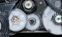 Rodas plásticas da roda denteada de um cartucho de impressora fotos de stock