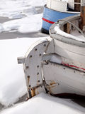Rodder. Stern and rodder of small fishingboat in frozen harbour Stock Photo