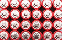 Rode aa-batterijen Stock Foto's