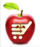 Rode appel met boodschappenwagentje. royalty-vrije stock afbeelding