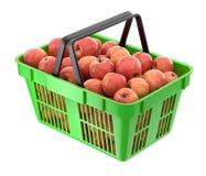 Rode appelen in de het winkelen mand Royalty-vrije Stock Afbeeldingen