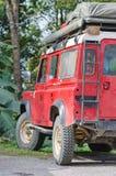 Rode avonturenauto Stock Foto