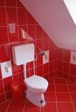 Rode badkamers stock afbeelding