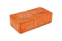 Rode baksteen die op witte achtergrond wordt geïsoleerdl stock afbeelding